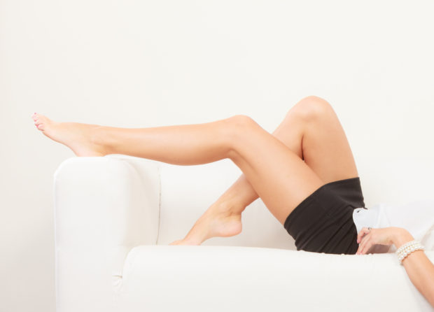 Body and skin care of female. Beauty long perfect legs of woman girl indoor. Depilation idea.