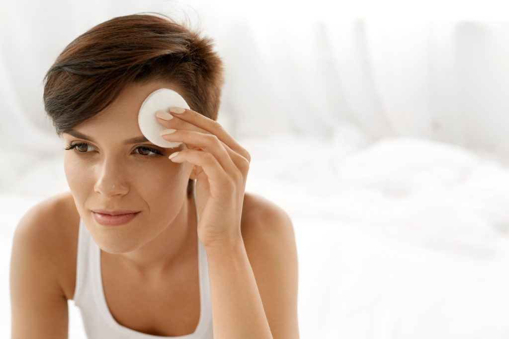Skin Care. Woman Removing Face Makeup, Cleansing Beauty Face