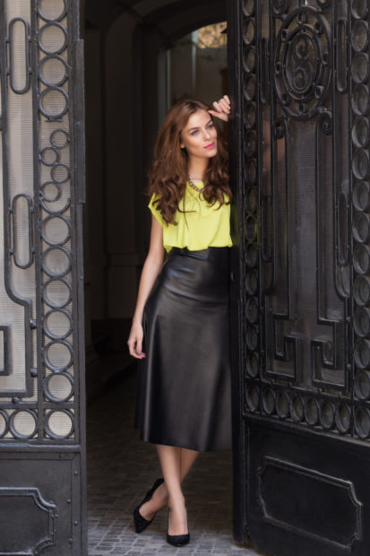 Citi chic girl with neon blouse and leather skirt