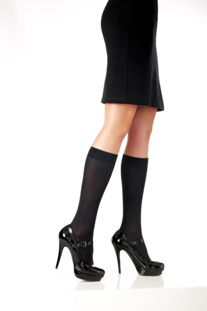elegant model legs with black skirt and fashion shoes