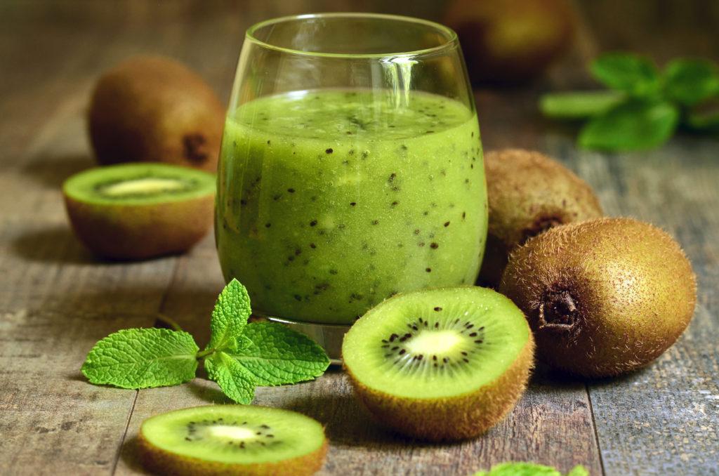 Fresh homemade kiwi juice in a glass.