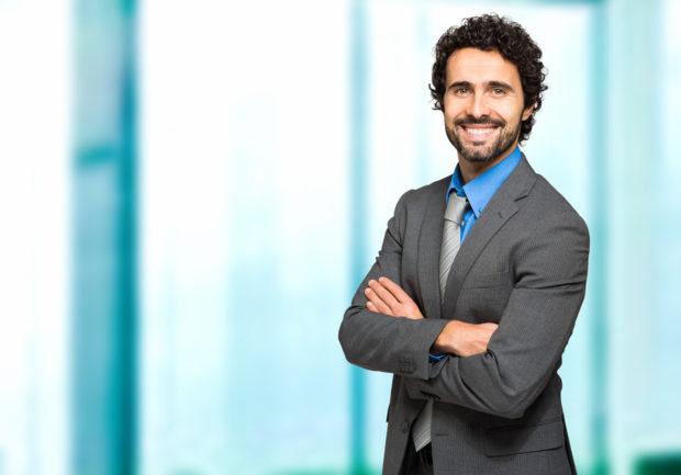 Friendly male manager portrait