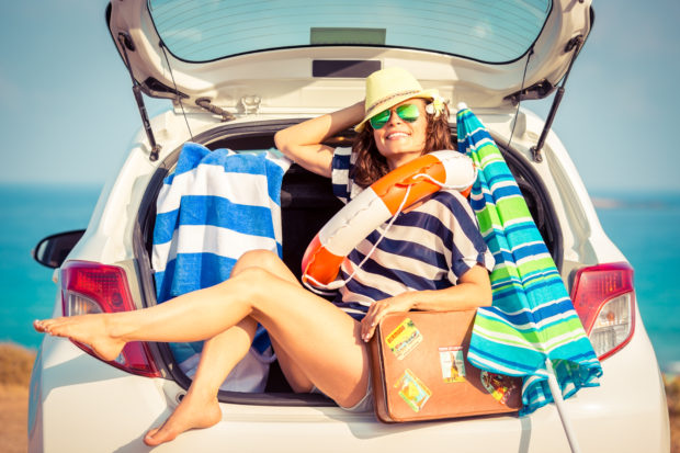 Woman on vacation. Summer holiday and car travel concept