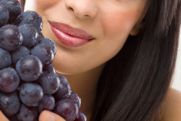 portrait of woman and fresh grapes