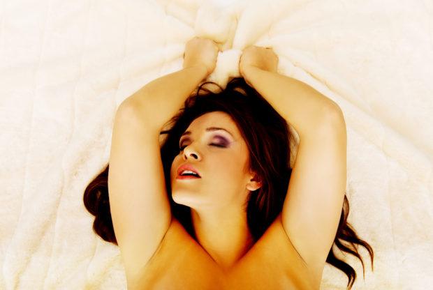 Young beauty sensual woman having orgasm.