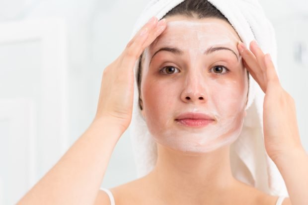 Beauty woman applying face mask after bath