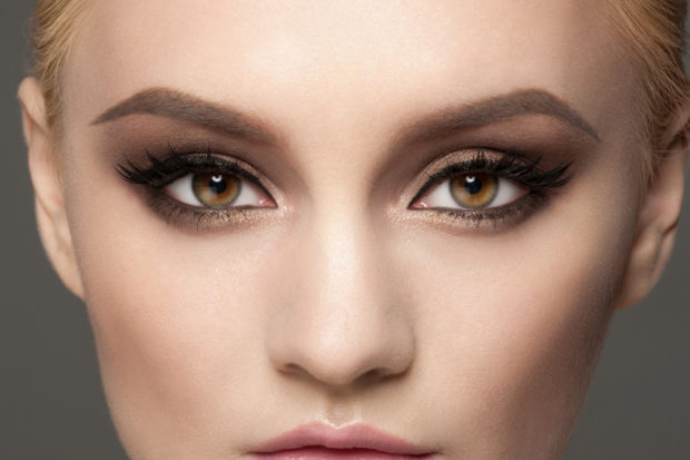 Closeup image of beautiful woman eyes with fancy bright makeup. Makeup with eyeliner and falce eyelashes