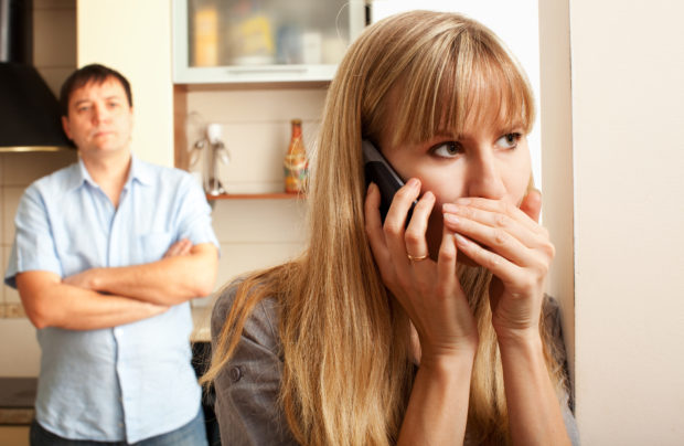 Wife confer privately on the phone
