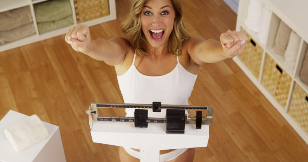 Happy woman celebrating weight loss