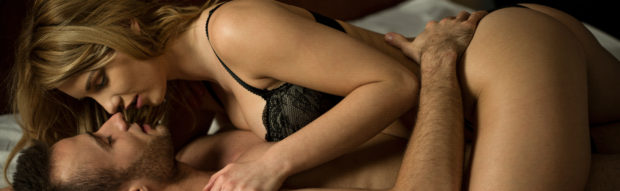 Young attractive sexy couple having sexual intercourse