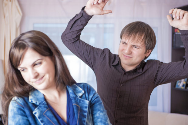 Family Violence Concepts. Young Caucasian Couple Quarrel Indoors.Horizontal Image