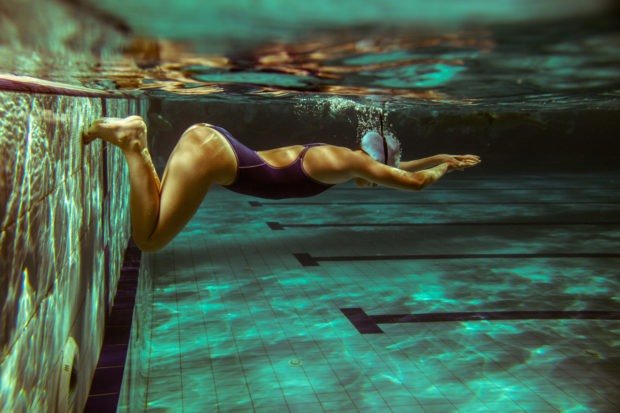 Swimmer at the swimming pool.Underwater photo.