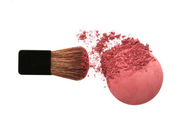 Crushed blush and brush isolated on white