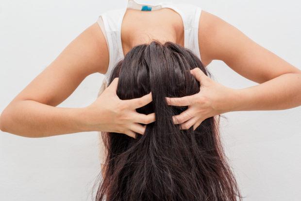 Women itching scalp