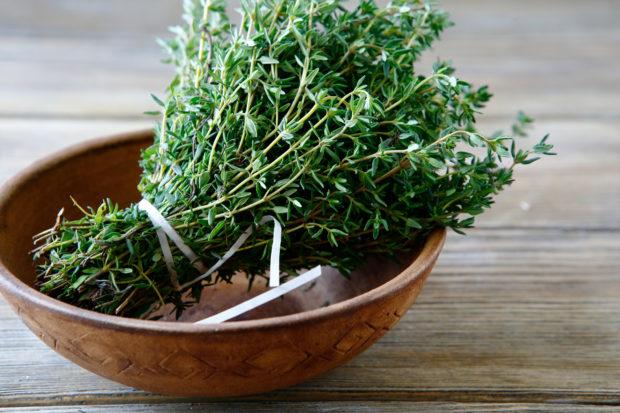 Fresh thyme in a bowl, closeup