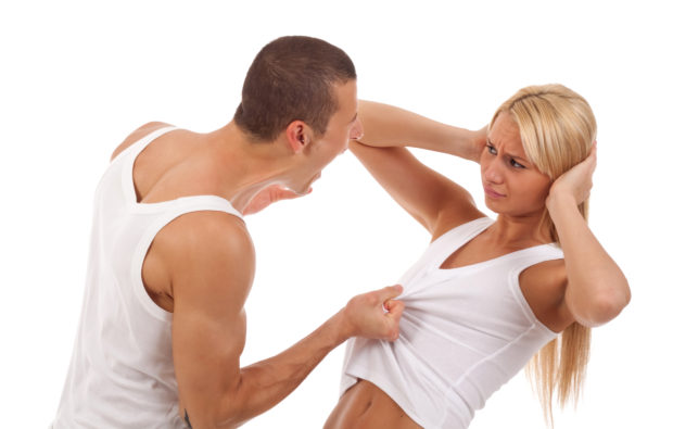 Domestic violence - picture of a man screaming and pulling his girlfriend's shirt