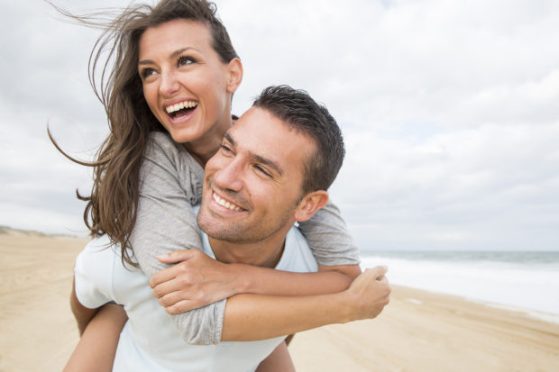 portrait of living young couple at the beach