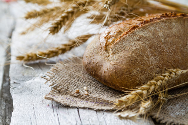 Bread on rustic wood background, copy space