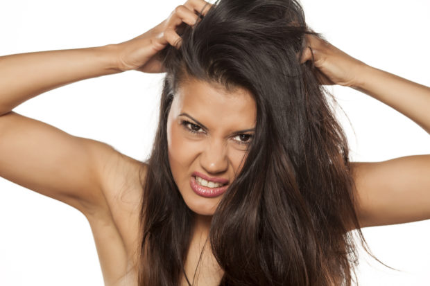 beautiful young latina has itching in her hair
