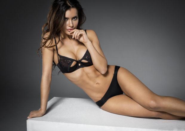 Seductive woman in black sexy lingerie