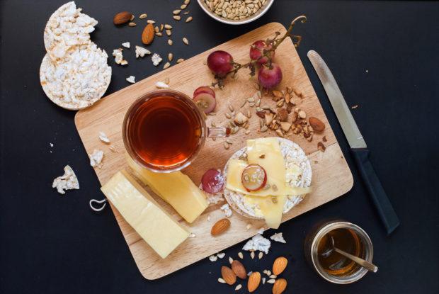 Healthy Breakfast Snack Tea Small Loaf Honey Cheese Grape Kinfolk Style Dark Table Top View